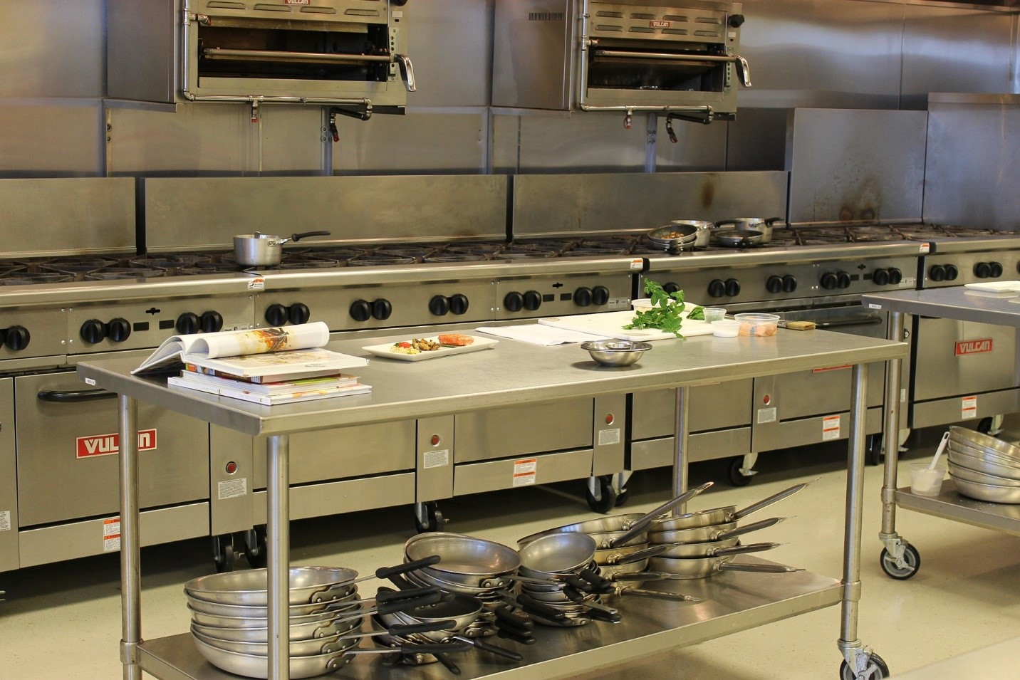 A large commercial kitchen with stainless steel appliances